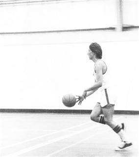 Paul Cocks brings up the back court 1970 - ish